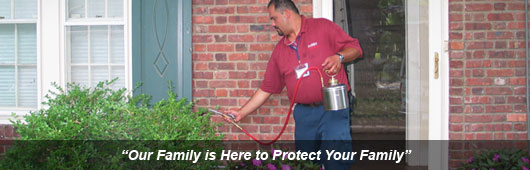Suburban Exterminating technician providing excellent service